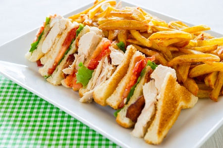 Chicken club sandwich in a white plate. Meal time.