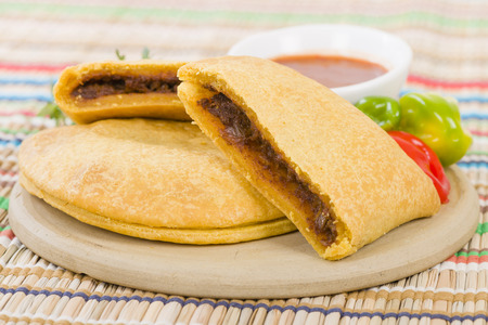Caribbean Jerk Beef Patty - Jamaican spicy minced jerk beef with onions and peppers in short crust pastry served with spicy sauce and scotch bonnet chillies.