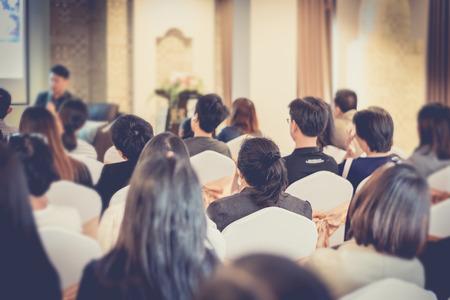 asia people listen speaker man in business seminar hall of hotel room,vintage filter,selective focus.
