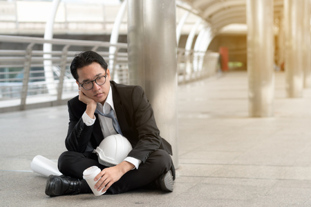 business fail concept : businessman stressed sitting ,problem life balance ,selective focus