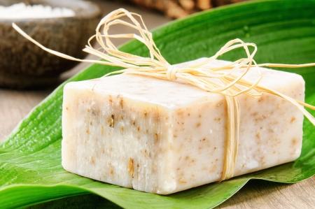 Natural handmade soap on a fresh green leaf