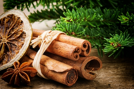 Photo for Cinnamon sticks, dried orange and aniseed on Christmas background - Royalty Free Image