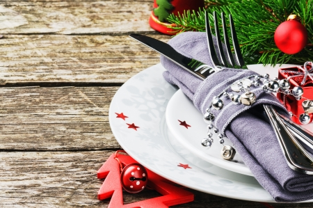 Christmas table setting on wooden table