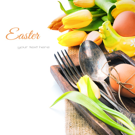 Easter table setting with yellow tulips and fresh eggs
