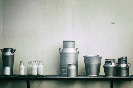 Old milk jugs, cans and bottles at dairy farm