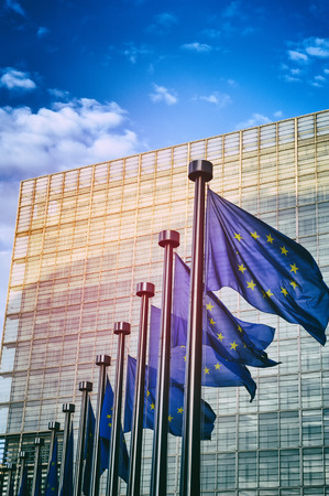 EU flags in front of European Commission in Brussels, Belgium