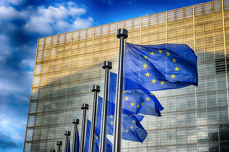 EU flags in front of European Commission building in Brussels