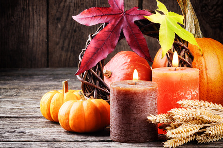 Photo for Autumn still-life in orange tone with pumpkins and candles - Royalty Free Image