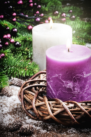 Christmas decorations with candles in purple tone