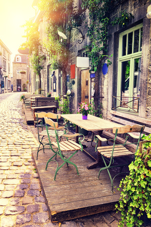 Photo for Cafe terrace in small European city at sunny summer day - Royalty Free Image