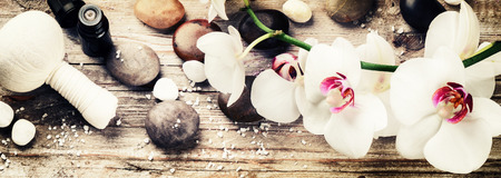 Foto de Spa setting with white orchid, herbal massage ball and essential oil. Wellness concept - Imagen libre de derechos