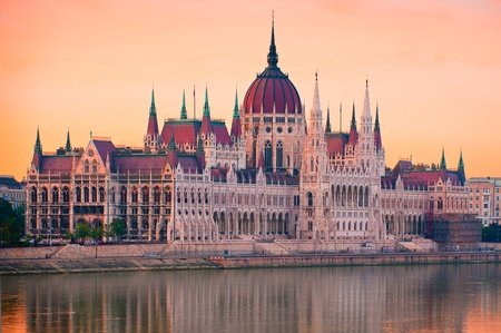 The House of Parliament, Budapest, Hungary, bathing in red morning light on eastern banks of River Danube
