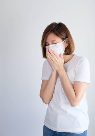woman wearing mask and cannot breath get sick from corona virus, covid19, flu symptom .