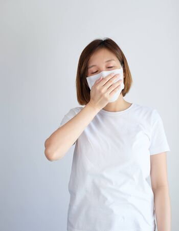 woman wearing mask and cough get sick from corona virus, covid19, flu symptom .