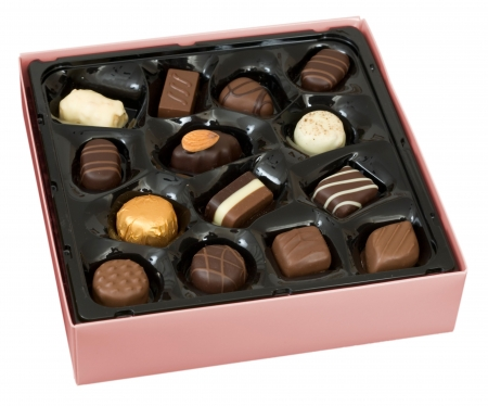 Pink box of Belgian chocolates isolated on white