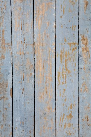 Grungy blue paintwork on a wooden panel