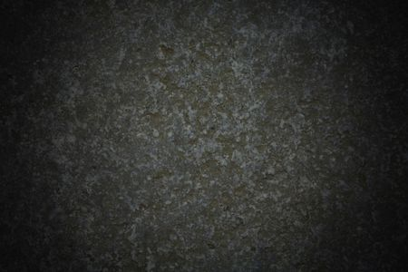 Dark grey stone background with vignette effect