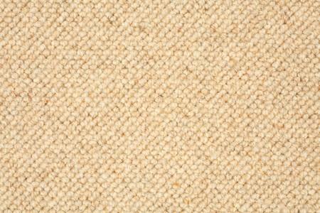 Closeup of a textured carpet in beige brown
