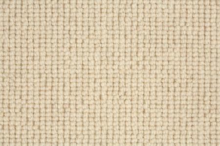 Detail of a loop pile berber carpet in natural colour