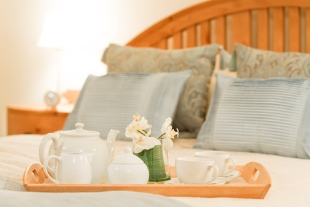 Breakfast tray on a bed in a traditional style bedroom