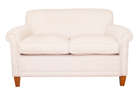 Modern neutral cream sofa isolated against a white background with clipping path