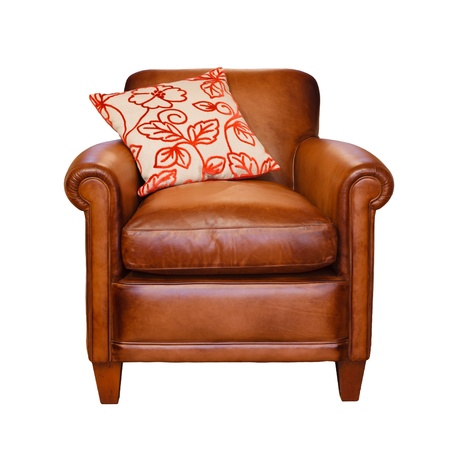 Leather armchair with trendy cushion on a white background with clipping path