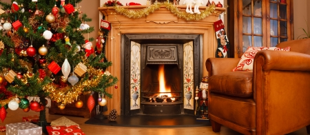 Christmas interior fire place in a living room in panoramic format