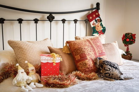 Christmas interior of modern bedroom with wrought iron bed