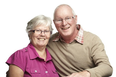 Portrait of senior couple smiling on white background