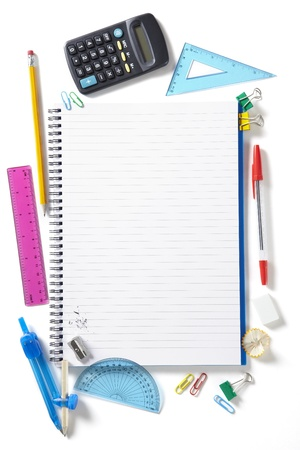 Back to School pupils note pad and stationary on white school desk from above