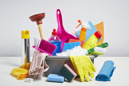 House cleaning products pile. Household chore concept on white background