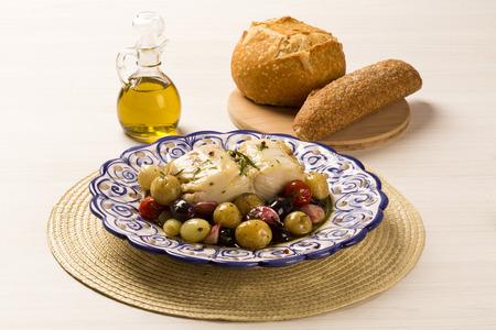 Foto de A typical Portuguese dish with codfish called Bacalhau do Porto in a original portuguese plate. Cod Fish Prepared. - Imagen libre de derechos