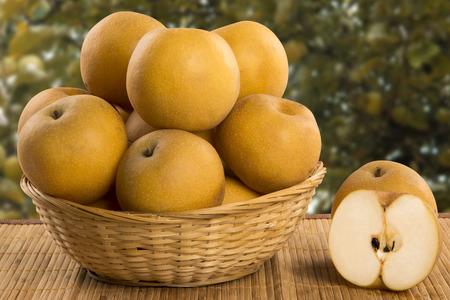Photo pour Some asian pears over a wooden surface. Fresh fruits - image libre de droit