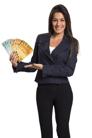 Foto de Young woman with real money in her hands, isolated on white background - Imagen libre de derechos