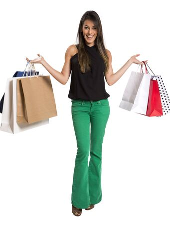 Foto de happy cute young woman shopping with color bags - isolated on white background - Imagen libre de derechos