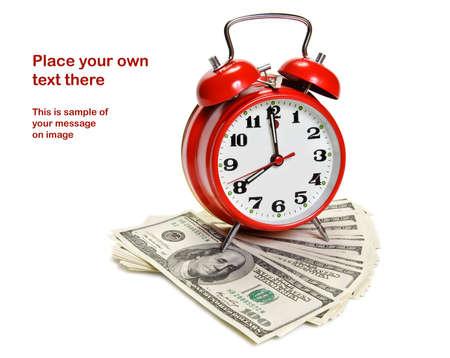Alarm clock over pile of money