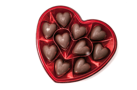 Photo pour Heart shaped box of Valentine's chocolate candy isolated on white - image libre de droit