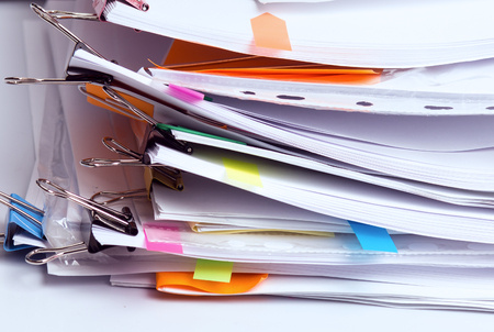 Foto per Pile of unfinished documents in office, stack of business reports, paper work - Immagine Royalty Free