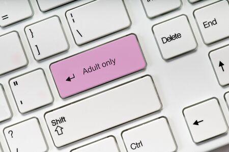 Photo pour Adult only pink key button on white keyboard. Online sex concept - image libre de droit