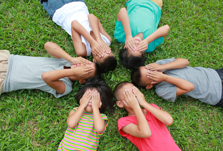 Six children playing in the park.