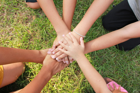 Multicultural hands in a community