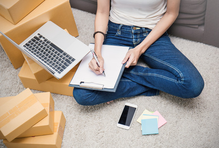 Start up small business entrepreneur SME or freelance asian woman working with box at home concept, Young Asian small business owner at home office, online marketing packaging box and delivery, SME concept