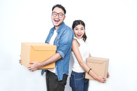 Photo for Asian woman and asian man carry boxes. Start up small business entrepreneur SME or freelance asian woman and man working with box, online marketing packaging box and delivery, SME concept - Royalty Free Image