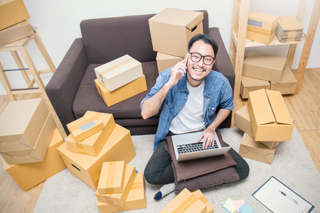 Photo for Start up small business entrepreneur SME or freelance man working at home concept, Young Asian small business owner at home office, online marketing packaging and delivery, SME concept top view - Royalty Free Image