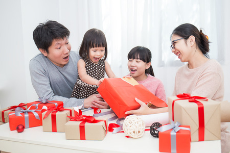 Photo for Asian family in sofa giving presents for Christmas, asian family celebrate Christmas boxing day open the gift - Royalty Free Image