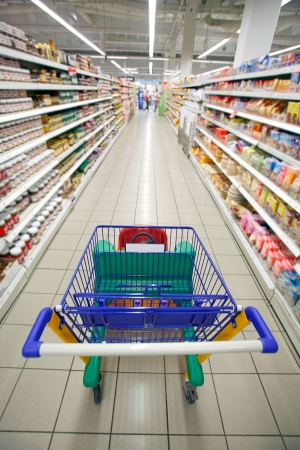 Supermarket cart traveling down the aisle for a shop