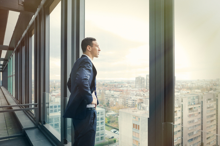 Foto per Business man looking out through the office balcony. Post processed with vintage filter. - Immagine Royalty Free