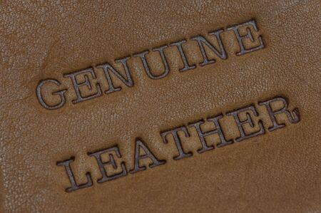 genuine leather printed text burned into a piece of skin