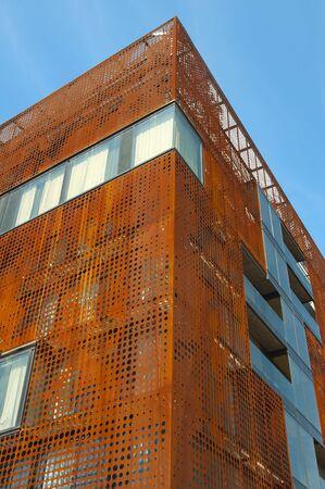 modern building with rusty metal skin