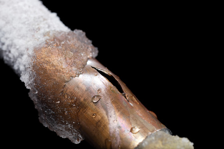 A pipe showing freeze damage